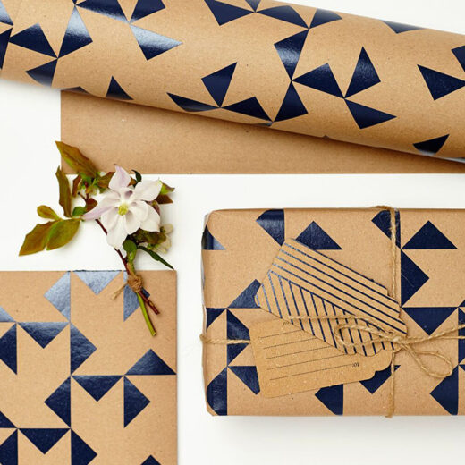 Beautiful navy windmill print pattern on kraft wrapping paper, 2 sheets made in the UK