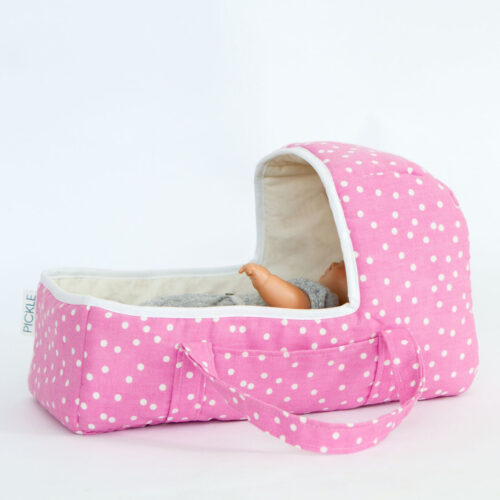 Doll carry cot in pink random dot made in wales