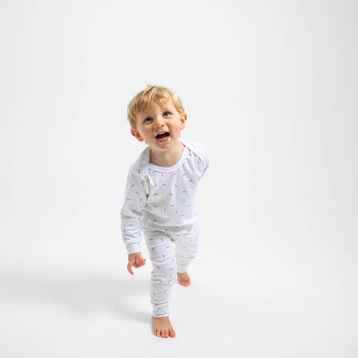 boy wearing white pyjama with the word pickle printed in small and sprinkles all over