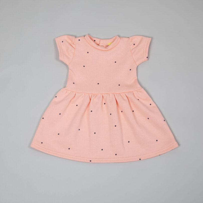 coral sweatshirt dress with random black polka dots print