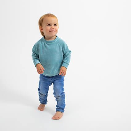 boy wearing mint green velour sweatshirt
