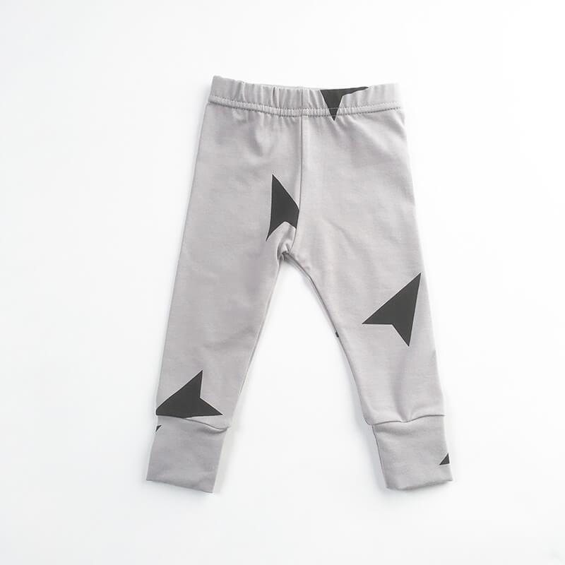 large black arrows on grey leggings