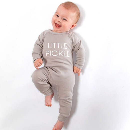 cute boy wearing grey romper with little pickle printed in white