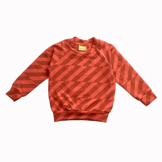 diagonal grey stripes on bright orange sweater