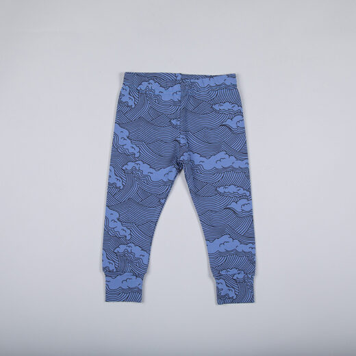 Flat lay of storm blue leggings with a unique wave print