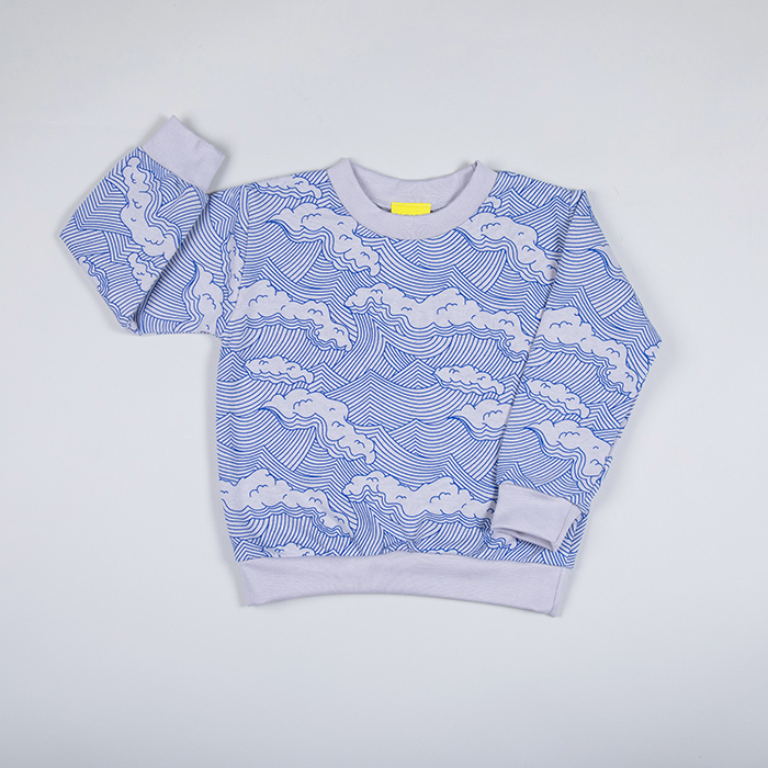 flat lay of grey sweatshirt with unique blue wave print